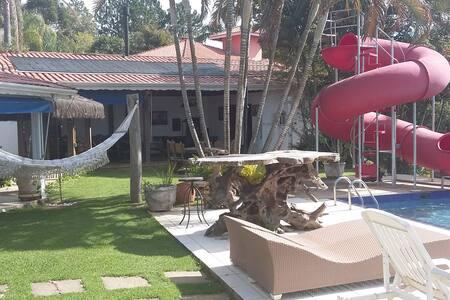 Charmoso Sitio no Cond Porta Do Sol conforto total - Haus