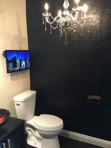 Ultra modern bathroom, talk on the phone, watch a movie or listen to music in the Rain shower!