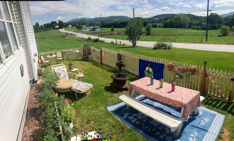 Sit back and relax.  Picket fenced in front yard perfect for kids & beloved pets with views of Jay Peak and the road is going towards our little village about one mile away.