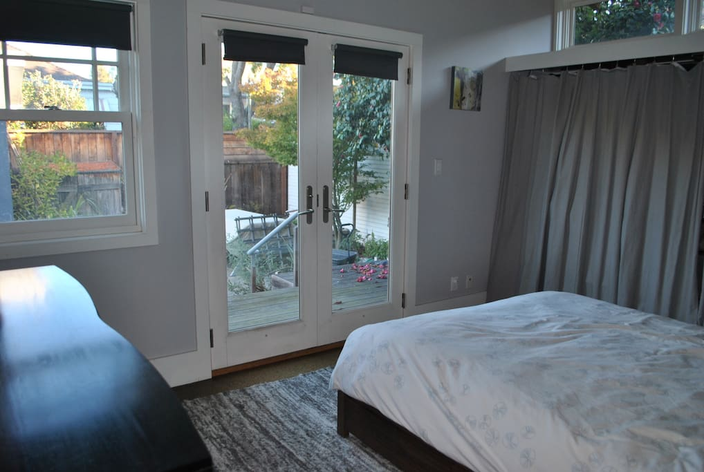 Master bedroom, with french doors opening onto the garden