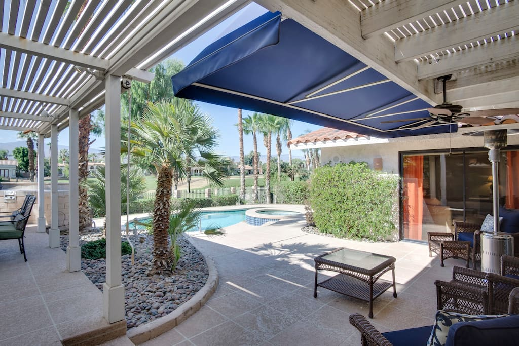 A warm outdoor living area provides comfortable shade.
