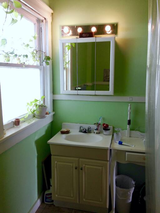 Shared full bathroom: counter space for guests by the sink. Please be mindful that this is an ANCIENT house- we scrub down the bathroom regularly and it will never look like new.