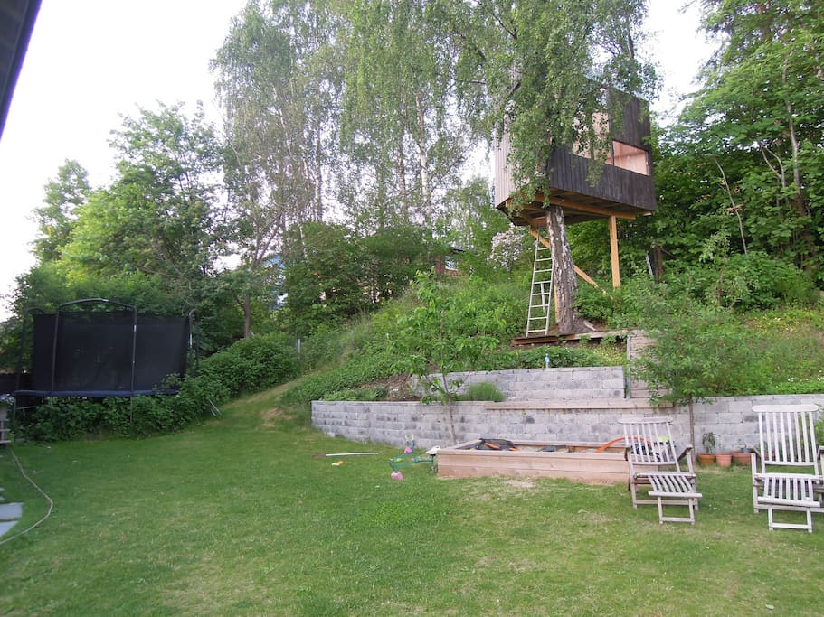 A large trampoline, treehouse and sandpit for the children
