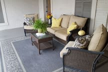 Shared veranda with one other apartment. Nice quiet place to sit and relax and view the manicured landscaping.