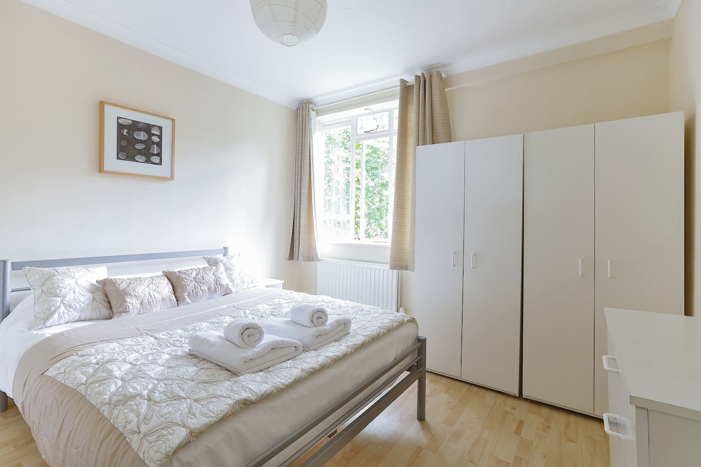 Bright and spacious bedroom for 2 people. Plenty of hanging and storage space.extra plug sockets under the bed and  there is a bedside light on the bedside table plus a fan for hot nights. Sleeping for 2 other people in comfy lounge sofa bed.
