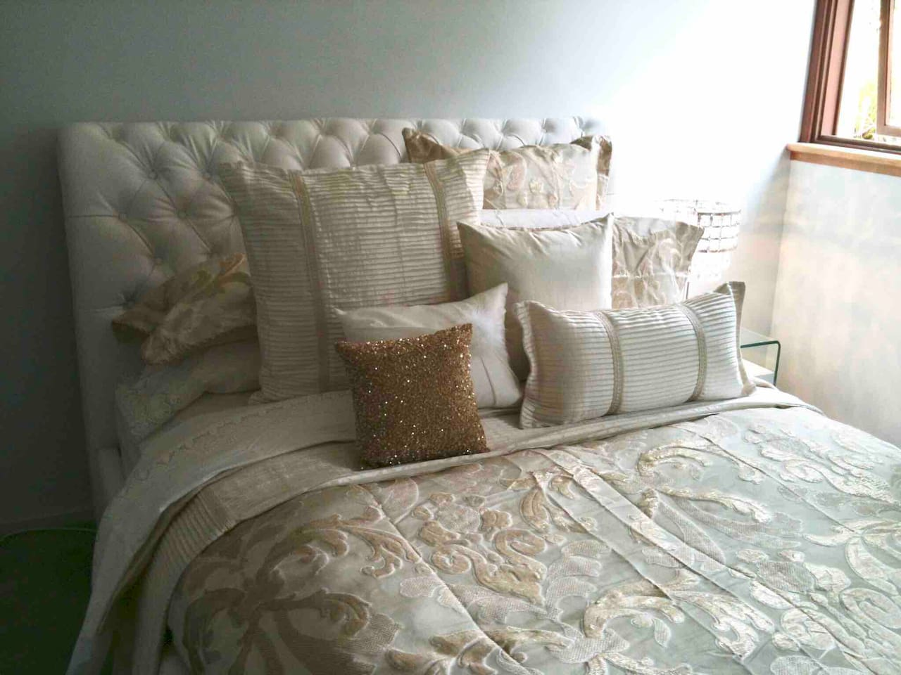 Your bed: elegant, comfy, with a luxurious 100% down doona