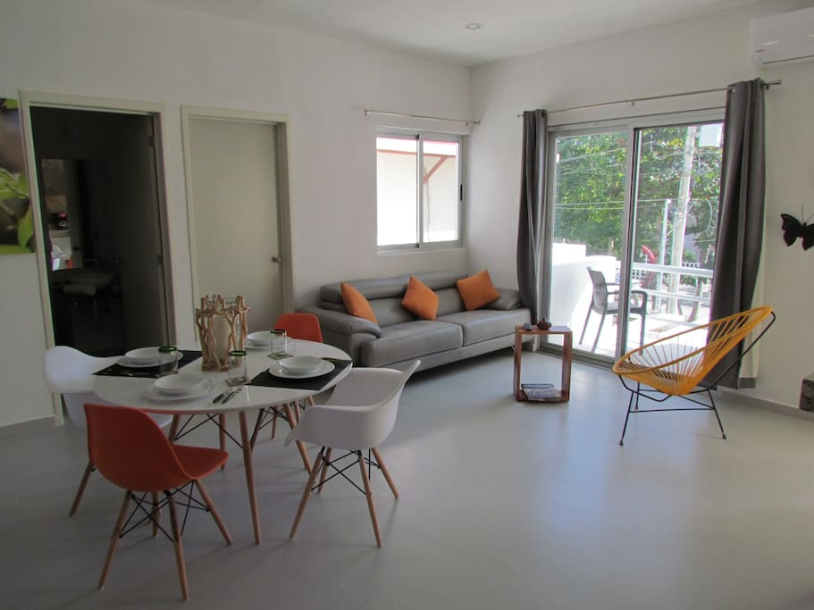Living and dining room with balcony