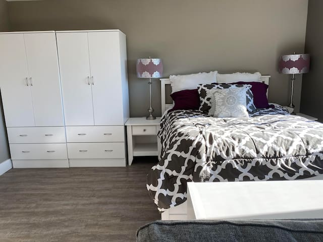 Queen size Bed with cozy linens. Double Closet space with  large drawers for storage.