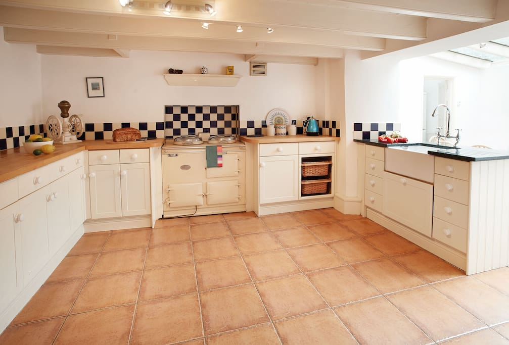 Lower ground floor: Kitchen with garden room for dining with French doors to garden