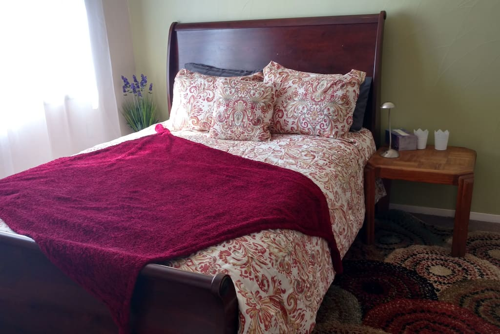 The room features luxury bedding.