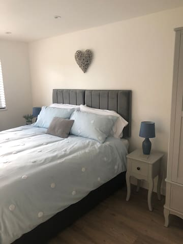 This kingsize bed can be split to two singles.