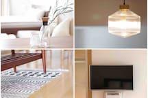 客厅的玻璃灯、干净的地板、床面前电视机+小米盒子