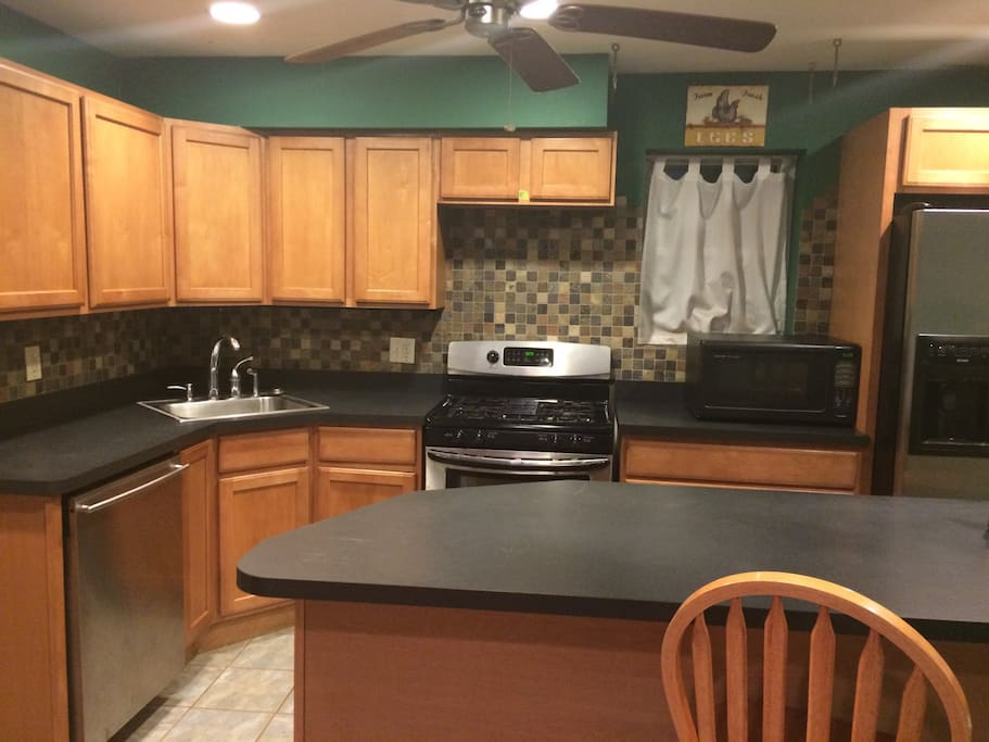 Large kitchen. Stainless steel appliances. Island with seating.