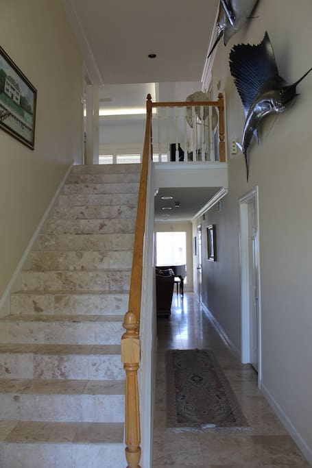 Entry way and stairs leading to the second floor