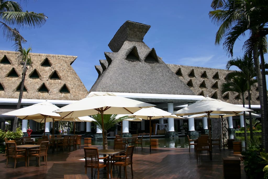 Savor tropical frozen drinks and lunch at one of the open-air restaurants or bars.