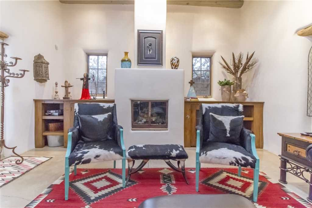 Choose your favorite - Grab a book or magazine and enjoy the warmth of the living room fireplace.