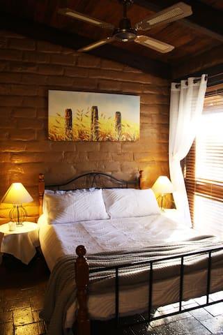 Bedroom 2. Double bed with en suite bathroom shared with Bedroom 3.