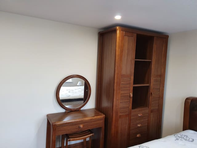 Wardrobe and dressing room table and chair