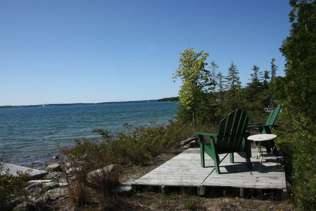 The shore is a lovely spot to spend any part of the day. Small deck, chairs and a 50 foot dock. Mushroom mooring for your sailboat. Wooded. Private. Gorgeous.