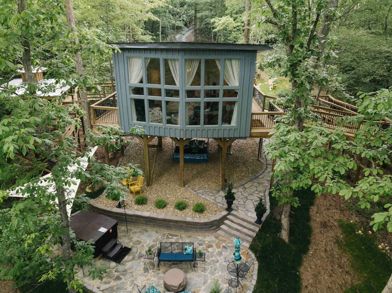 Drone photo of treehouse that faces the forest!
