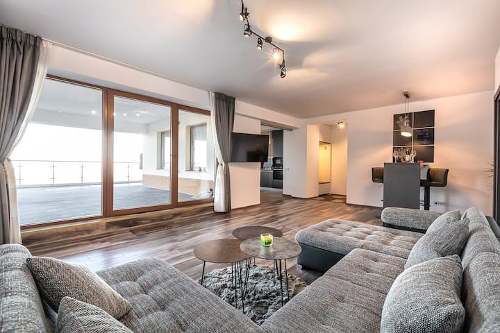 Modern apartment with city-view near Poiana Brasov
