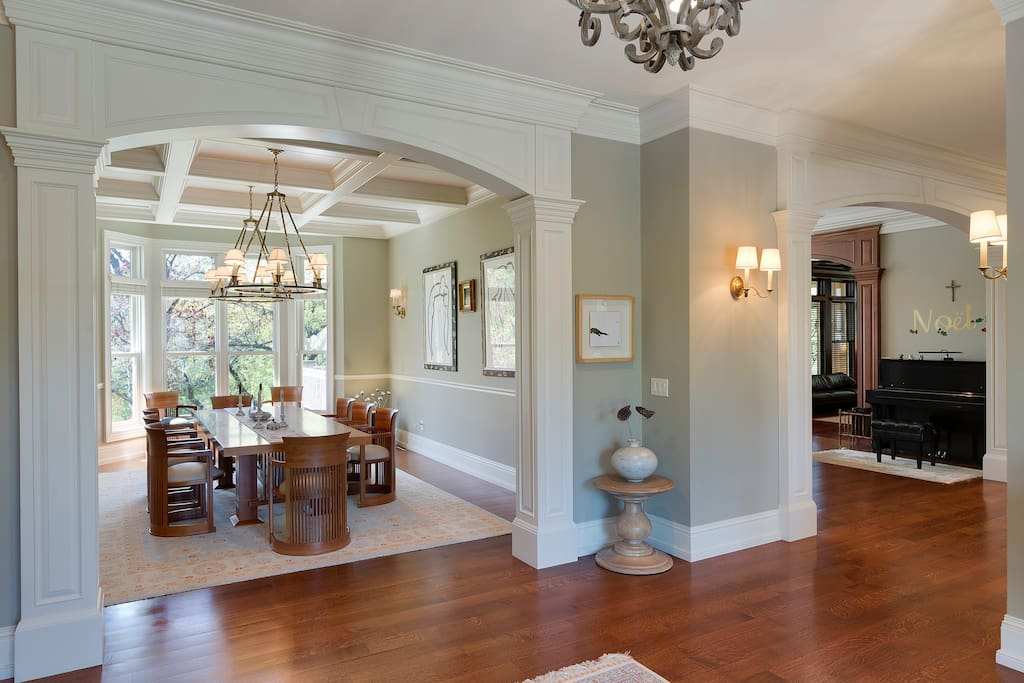 Foyer opens into formal dining space, informal dining space, and kitchen.