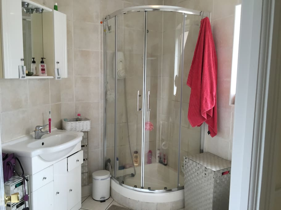 Upstairs bathroom with shower shared between two others.