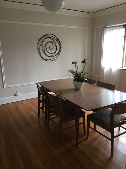 The spacious dining room has great natural lighting!