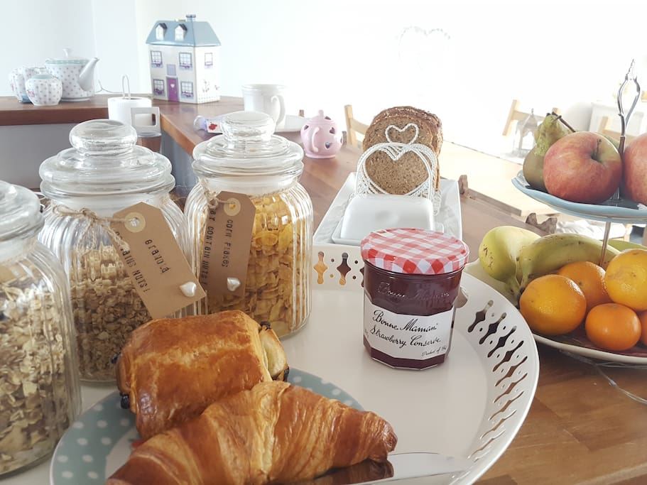 Breakfast comes with your booking: a selection of cereals, fruit, bread with spreads, pastry and a hot drink.