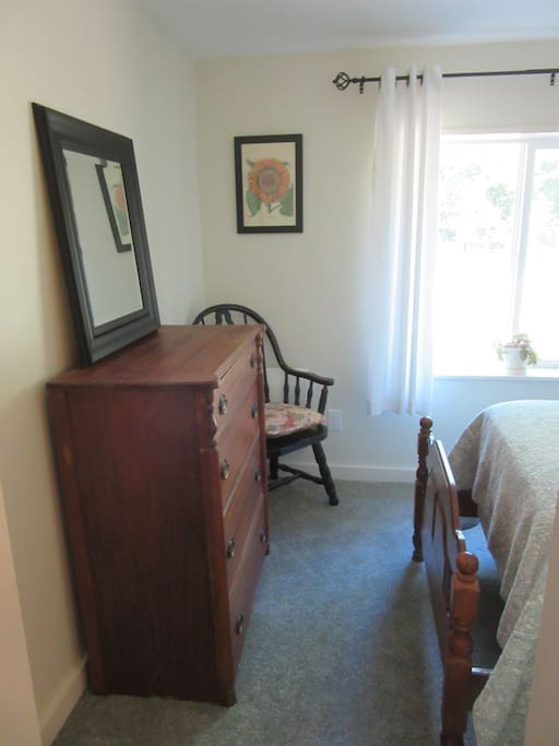 Your room features a dresser, single bed and  chair