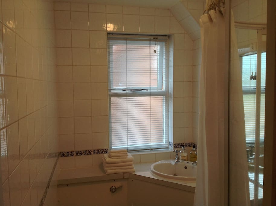 The shower room is airy and modern. We aim to keep it spotlessly clean!