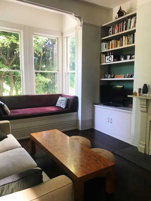 Spacious living room with sunny window seat. TV with Roku and access to Netflix & Amazon.