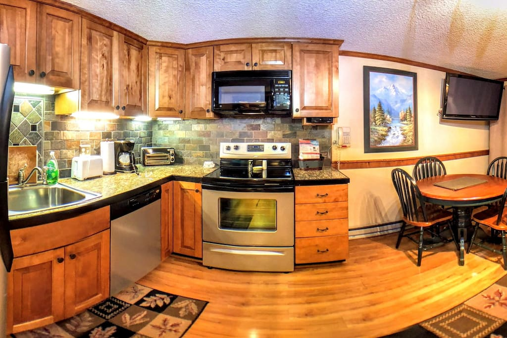 Fully-equipped kitchen with stainless steel appliances