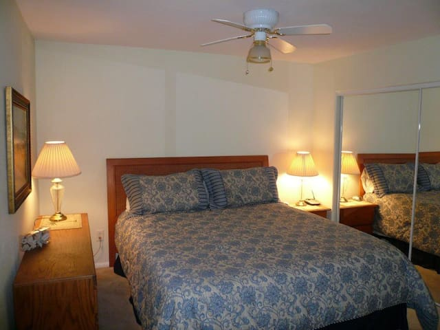 Comfortable master suite with king bed and private bathroom.