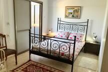 Master bedroom with a veranda