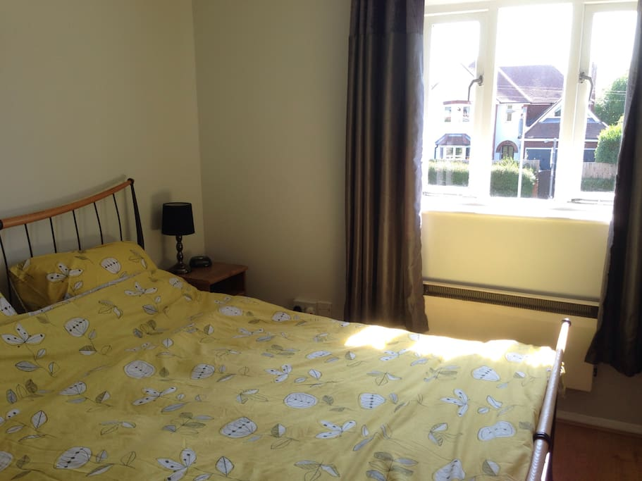 Windows of bedroom can be opened and/or curtains closed for shade while its hot. Clock radio next to the bed.