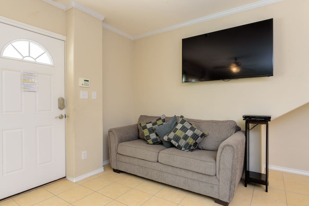 """55"""" Samsung flat screen TV with DVD player in the living room"""
