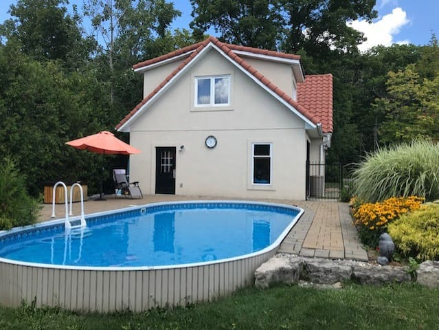 Summer guests have pool access. The sun-heated pool is great for playing water games, cooling off, or swimming laps. (Not deep enough for jumping or diving) The south facing patio and gardens provide a warm,  relaxing atmosphere for rest or play.