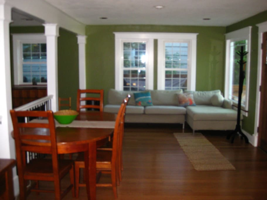 Second sofa and dining table on main floor