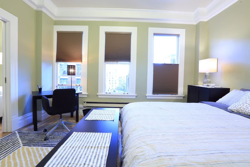 3 large wall to wall windows with adjustable blinds to direct light as needed.