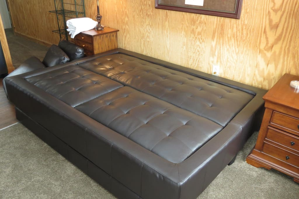 Sofa bed converted into queen bed