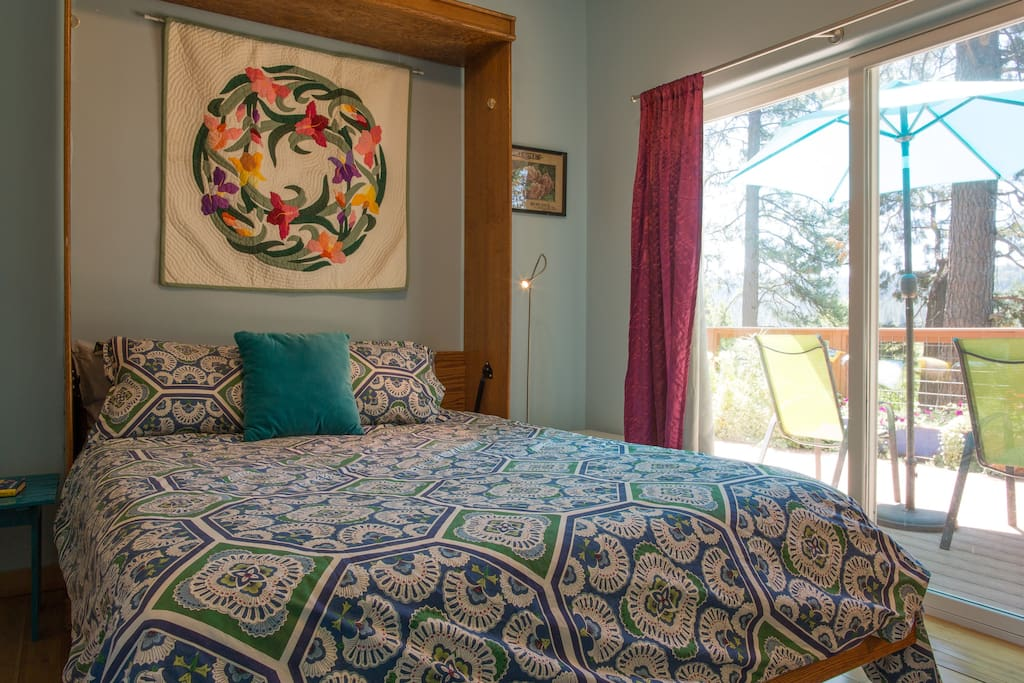 Queen bed, private, opens out to deck. Beautiful views from bedroom.
