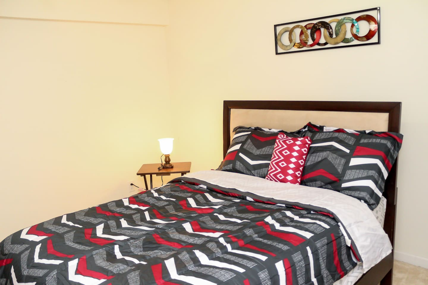 Full size bed with a comforter set.