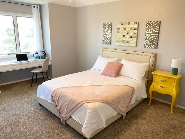 Large room with a queen bed and a desk to take a quick check of those emails before enjoying the rest of the day, worry-free!