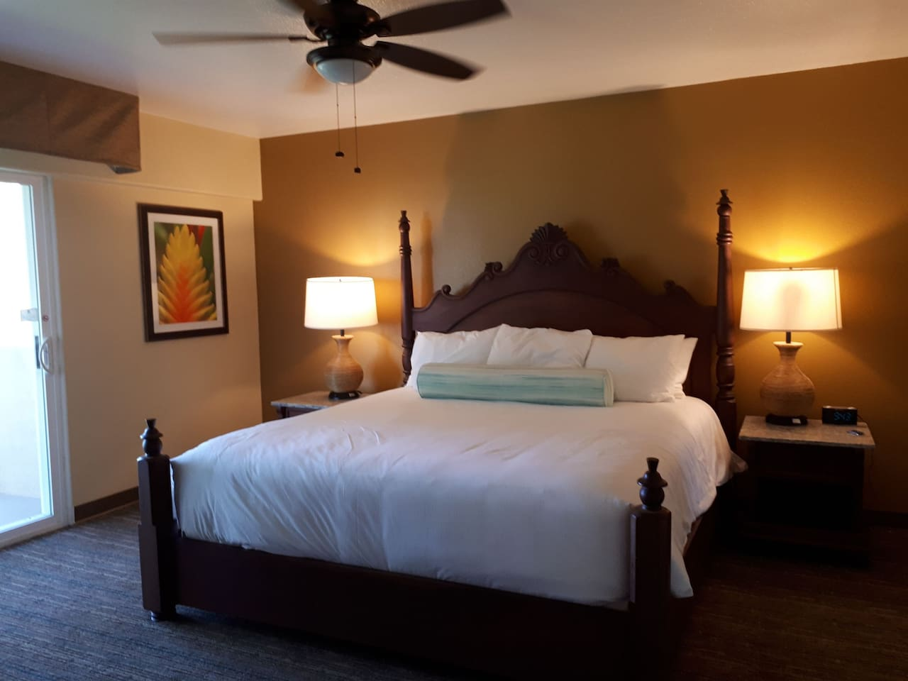 Master bedroom with king bed and authentic Hawaiian Koa wood bed frame