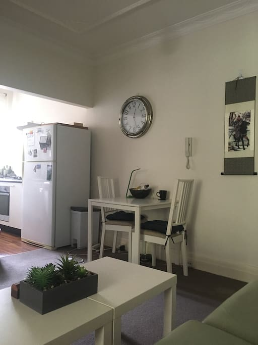 The living room connects to kitchen.