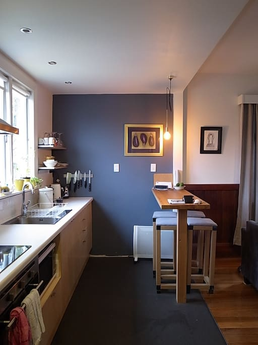 The renovated bright kitchen and breakfast bench