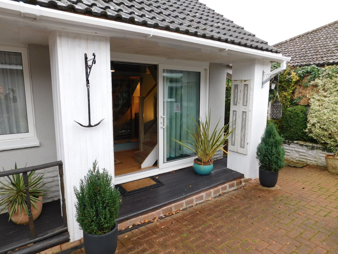 Private entrance to the annexe via sliding doors.