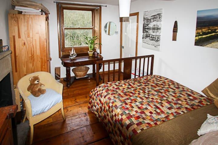 Room overlooks garden and woodlands
