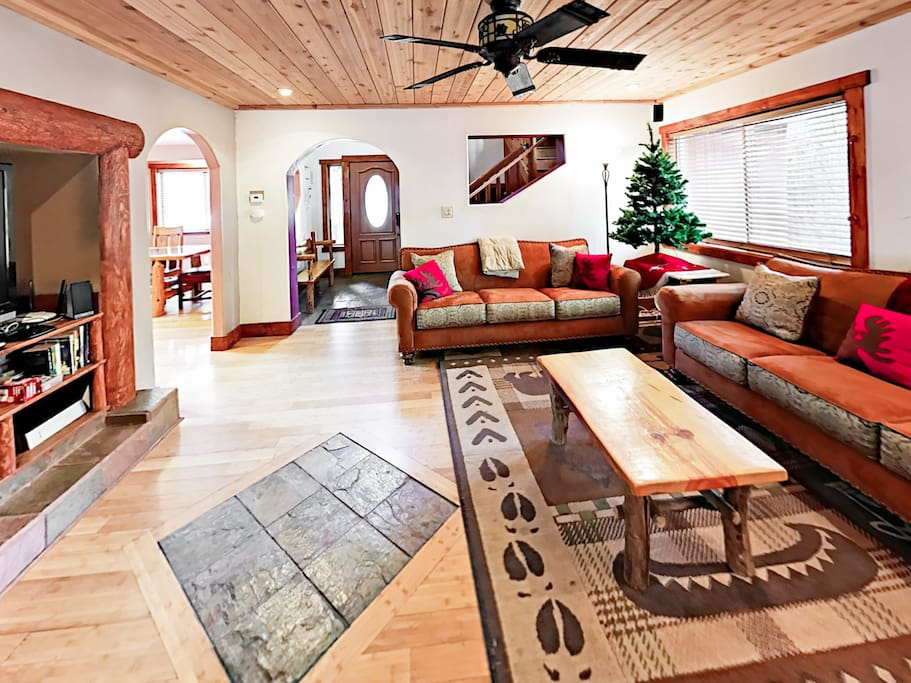 With all the charm of a rustic-chic log cabin, the living room has abundant seating for the whole family.